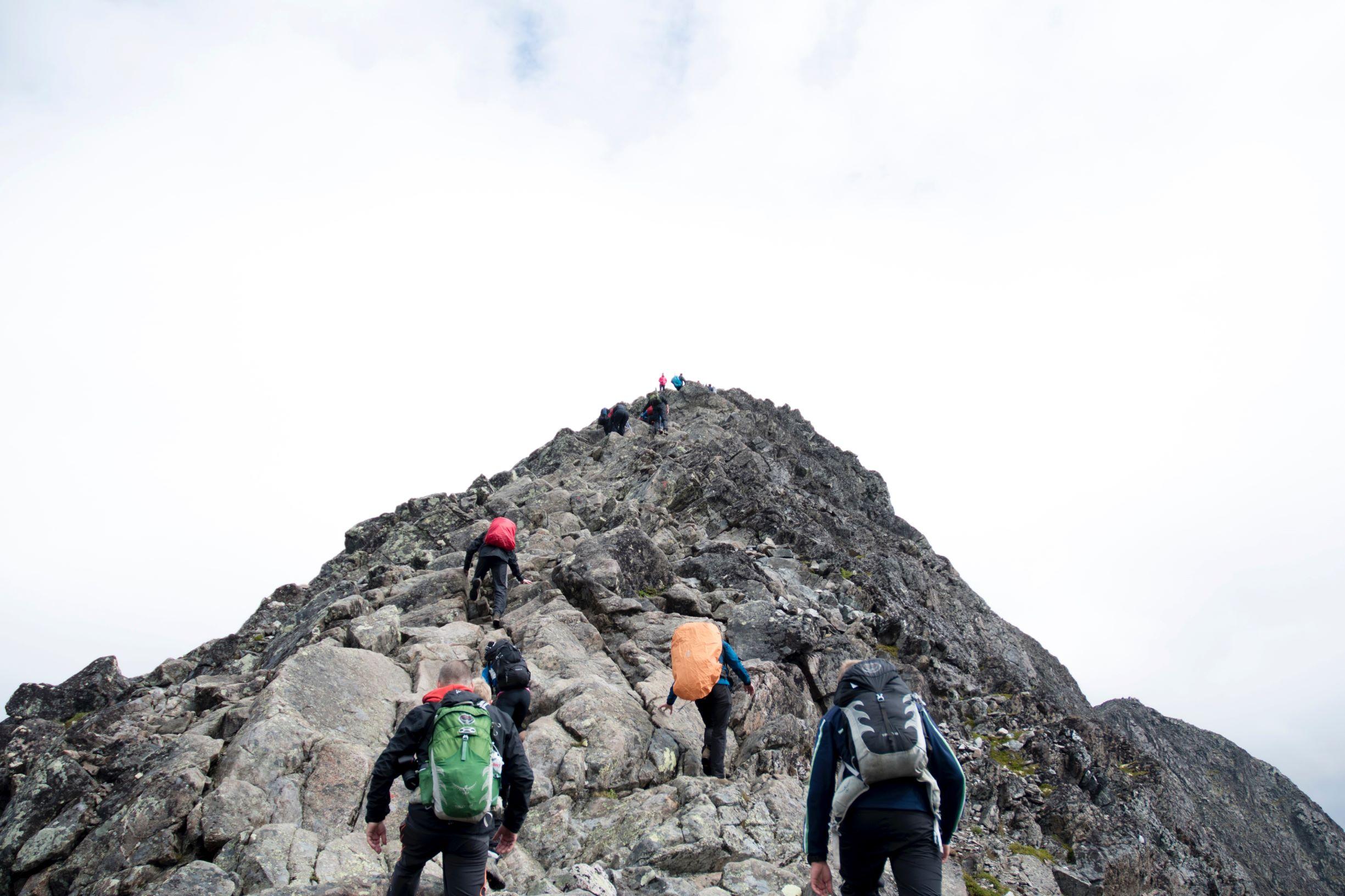 Team climbing the mountain Mathias Jensen